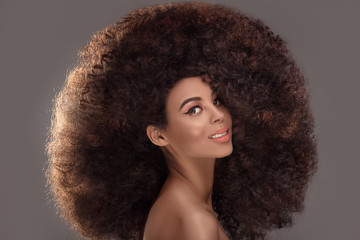 Beauty portrait of attractive woman in afro hairstyle.