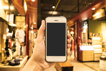 Young men are using mobile phones for various technologies such as online payment. Buy online