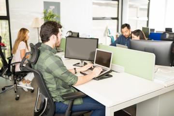 Software developer working at his desk