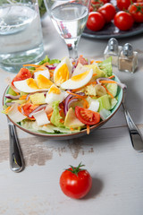 plate of vegetable salad with eggs and tomatoes