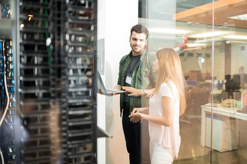 Colleagues discussing in office server room