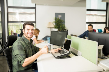 Man having coffee break at work