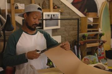 Man cutting cardboard paper