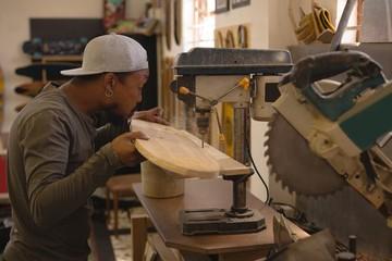 Man using radial drill machine