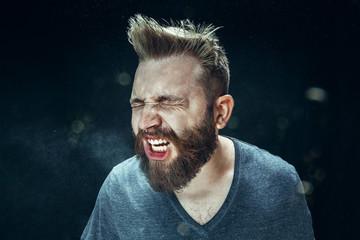Man sneezing indoors
