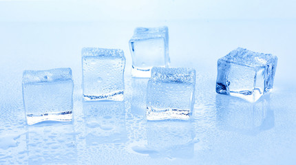 Cubes of ice on bule background