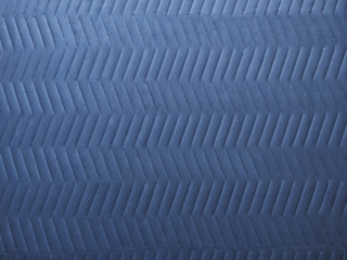 clean quilted chevron pattern on cool gray moving blanket or elevator tarp