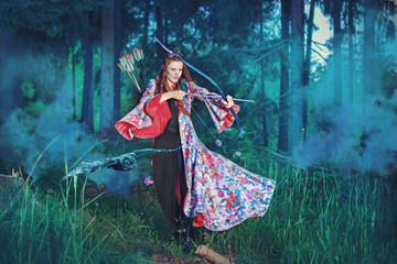 female elf with bow in a magic forest