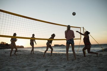 Female volleyball players playing volleyball