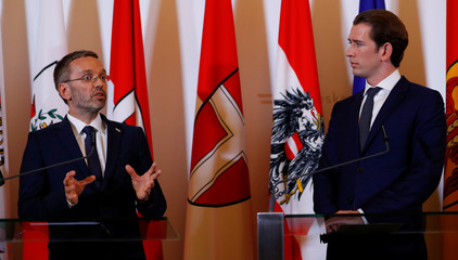 Austrian Chancellor Sebastian Kurz and Interior Minister Herbert Kickl attend a news conference in Vienna
