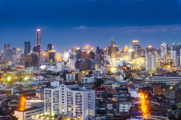 cityscape Bangkok skyline in Twilight night view, Thailand. Bangkok is metropolis and favorite of tourists live at between modern building / skyscraper, Community residents