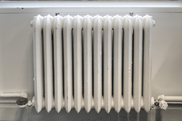 white painted cast iron radiator heater old school classic hot water heating system