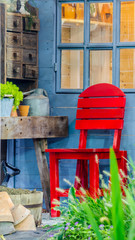 Relaxing area in cozy home garden on summer./ Relaxing area with garden object decoration and red chair in cozy home garden on summer.