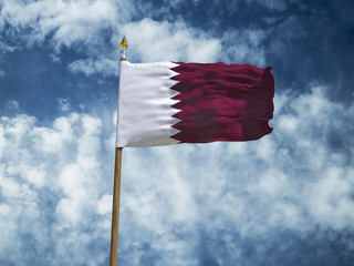 Qatar flag Silk waving flag of Qatar made transparent fabric with wooden flagpole gold spear on background sunny blue sky white smoke clouds real retro photo Countries of world 3d illustration