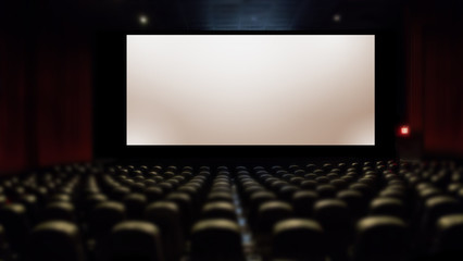big silver screen in movie theater with seating