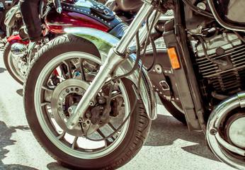front wheel motorcycle close-up, background with motorcycle