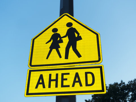 sign icon of man woman walking and word reading ahead