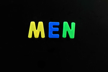 English letters in black background are the words men