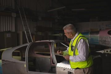 Engineer examining aircraft part