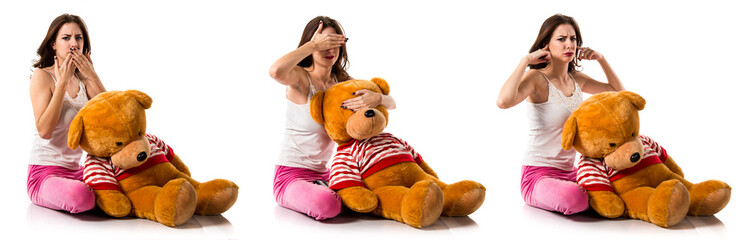 Pretty brunette girl with pajamas covering his eyes