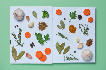 An open cookbook with pictures of living vegetables