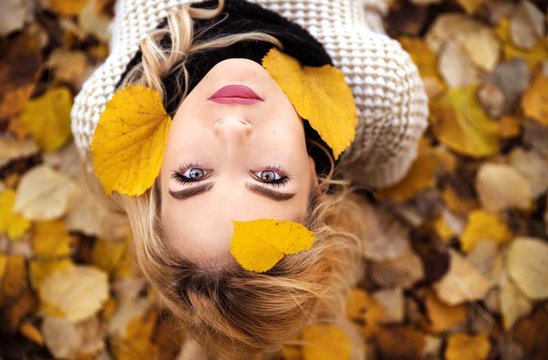 Young woman portrait in leaves