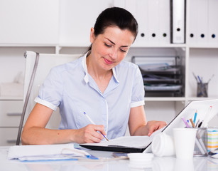 cheerful woman working in the office