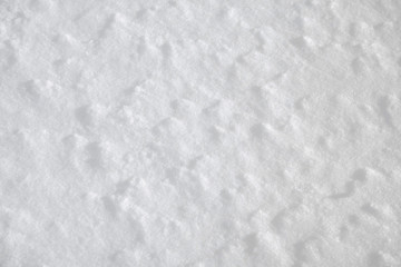Background winter texture of white and blue clean crystal of snow