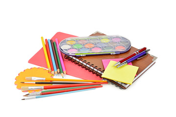 Pencils, paints, notebooks and other stationery isolated on a white background