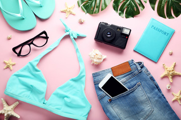 Blue swimsuit with jeans and starfishes on pink background