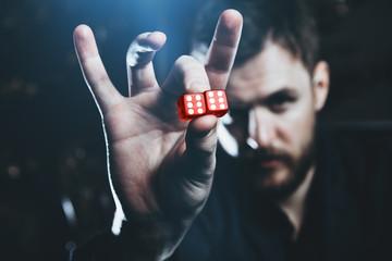 successful man shows dice