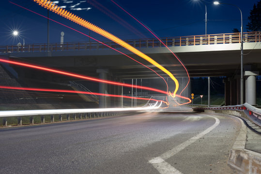 Large city road night scene, night car light trails. Road and highway overpass or viaduct