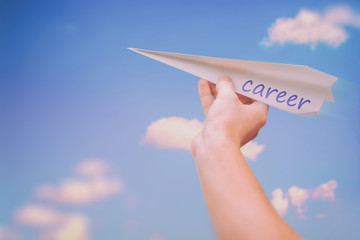 Ascending paper airplane as a metaphor for career advancement and successful career