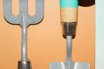 Close-up: image of new two garden tools: shovel and rake. A simple useful gift for a gardener. Concept: gardening.