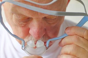 Closeup senior with CPAP equipment