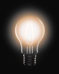 Lit LED light bulb on a black background