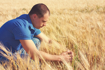 Young man in the farm - wheat field - countryside life