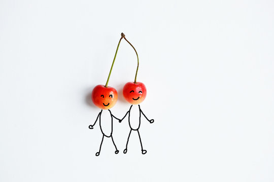 cherry with hand drawing shapes of couple in love