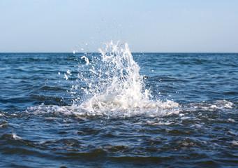 Blue water splashing
