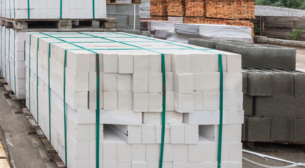 White bricks folded on pallets