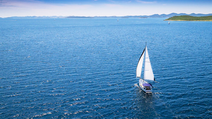Door stickers Sailing Sailing boat on open water, aerial view