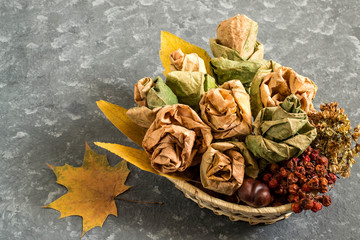 Bouquet of roses made from autumn maple leaves