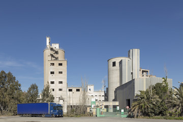 general view of the cement plant of Sagunto, with a truck on the facade, Valencia, Spain