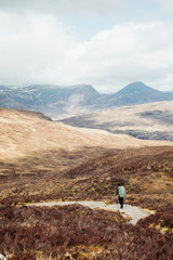 A hiker walking in the Scottish Highlands