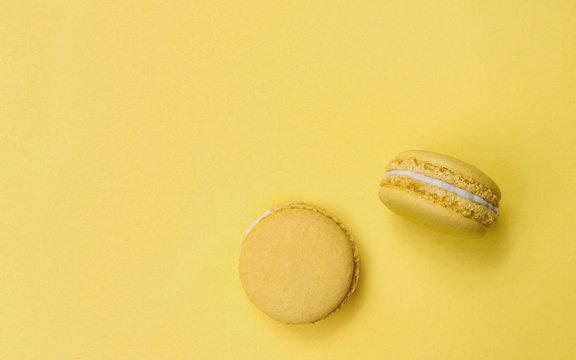 Lemon flavor Macarons on yellow background