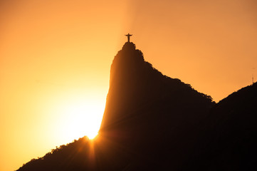 The famous Rio de Janeiro landmark - Christ the Redeemer statue on Corcovado mountain. Silhouette by sunset