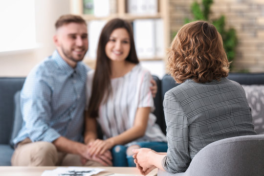 Psychologist working with married couple in office