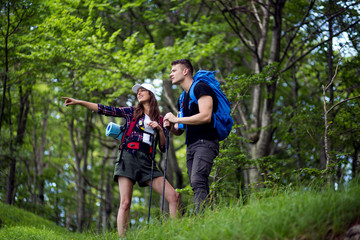 Couple enjoying on their hiking trip.Travel and adventure concept