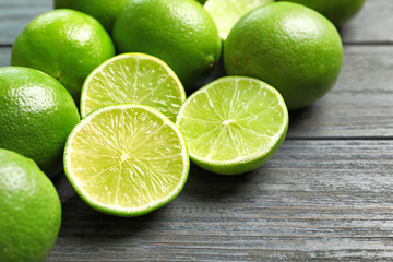 Fresh ripe limes on wooden table. Citrus fruit