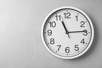 Modern clock on grey background, top view. Time management